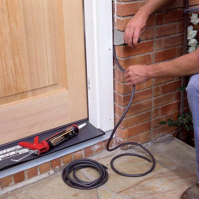 Apply caulk backer and caulk door