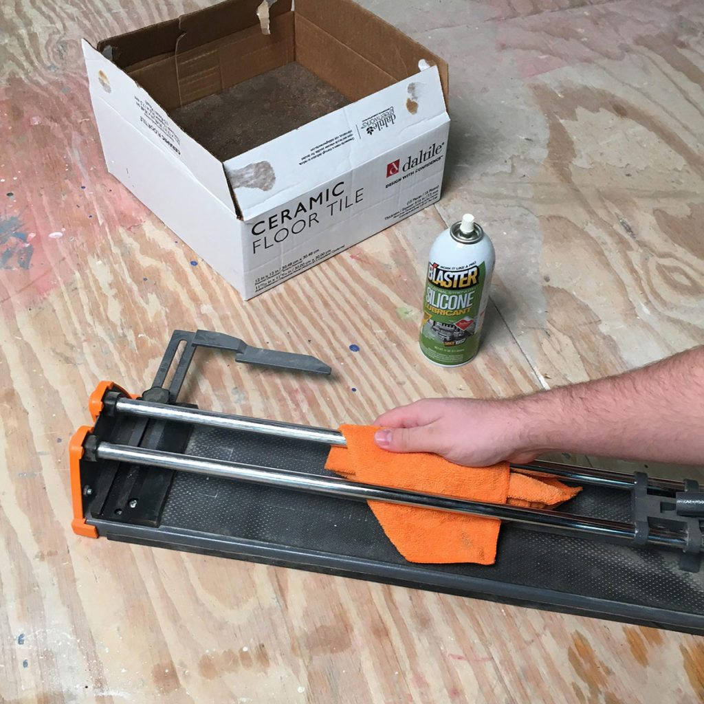 Tile cutter being cleaned with silicon | Construction Pro Tips