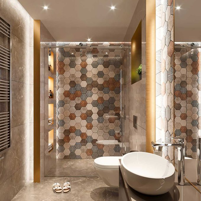 Blue, orange and neutral mosaic tile in a bathroom