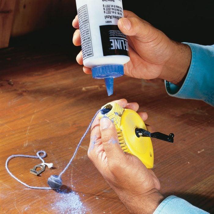 Loading blue chalk into a chalkline   Construction Pro Tips