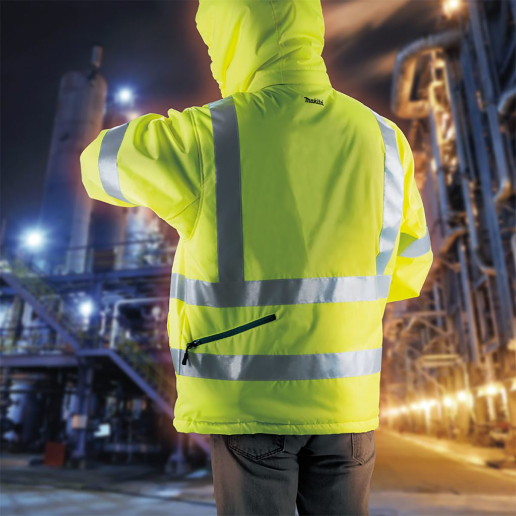 Worker wearing a heated and reflective jacket | Construction Pro Tips