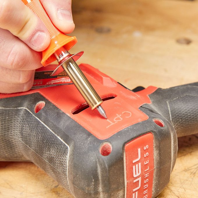Marking a plastic tool with a soldering iron | Construction Pro Tips