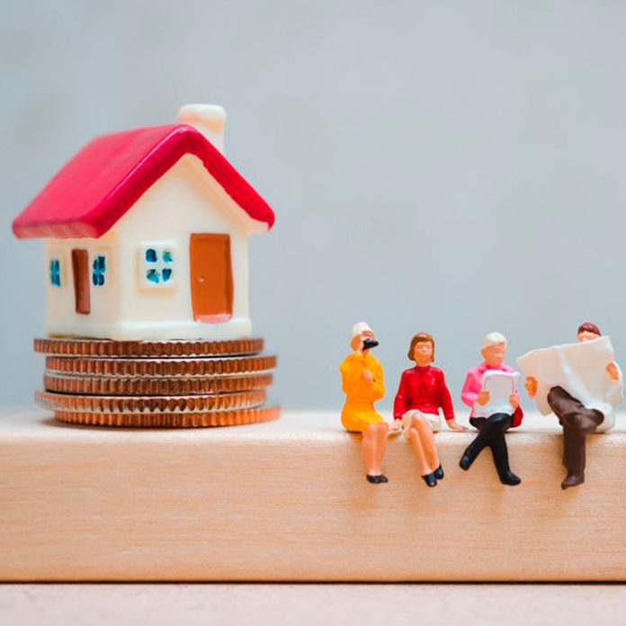 miniature house with people about smart taxes