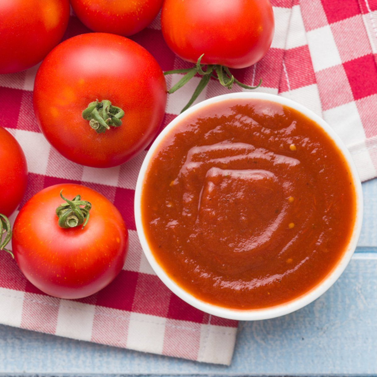 Tomatoes and ketchup. Top view.; Shutterstock ID 1154678266