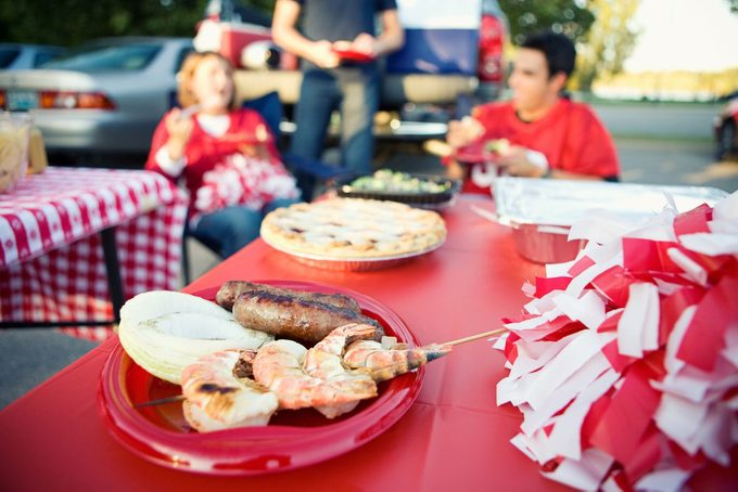 Tailgate party with a table full of food