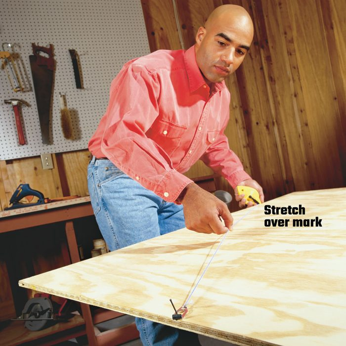 Stretching past a mark to make a line with a chalkline   Construction Pro Tips