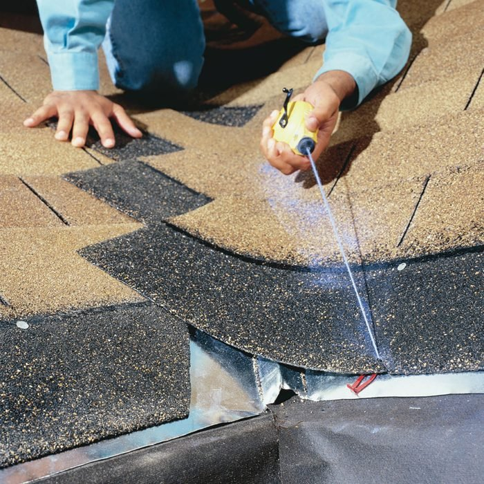 Snapping a chalk line on shingles   Construction Pro Tips