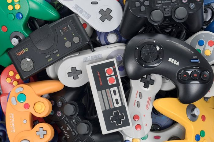 Taipei, Taiwan - February 19, 2018: A pile of retro video game controllers shot from above.