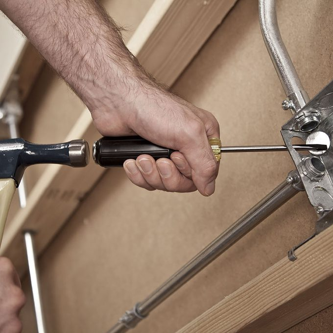 Striking the back of a demo screw driver | Construction Pro Tips