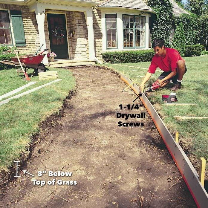 drive stakes every 3 feet concrete sidewalk