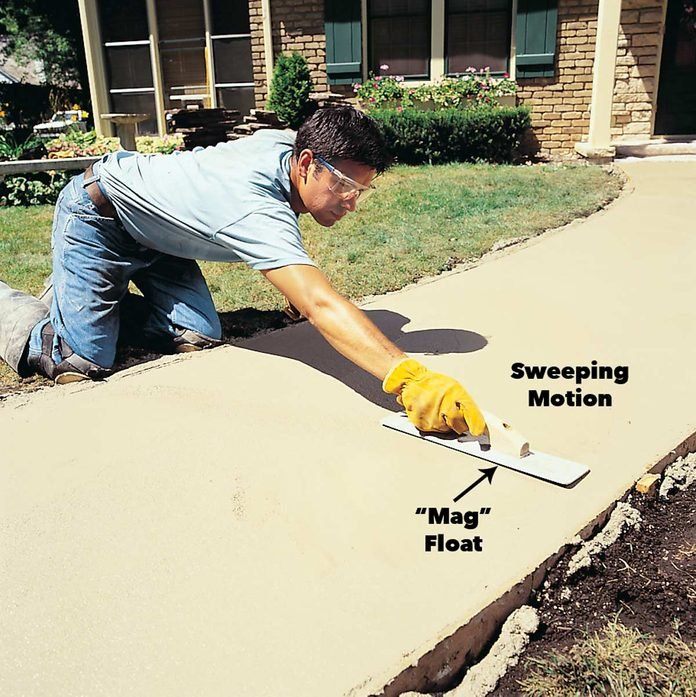 Smooth concrete sidewalk with a mag float