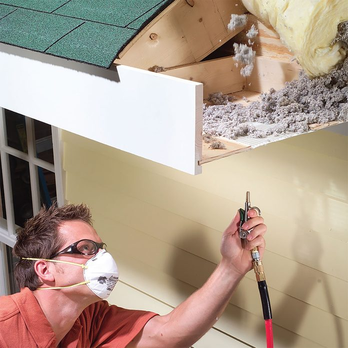 Blowing foam off of a soffit | Construction Pro Tips