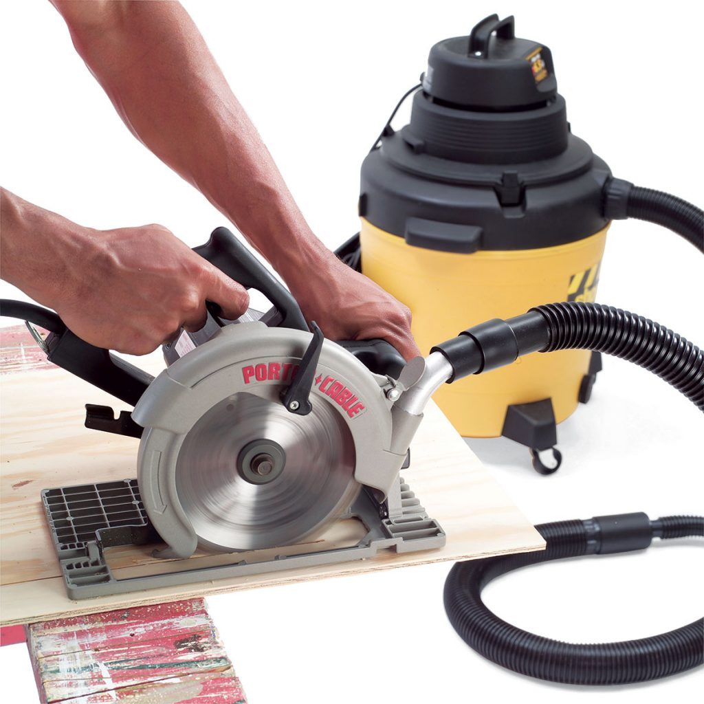 Cutting wood with a circular saw attached to a vacuum | Construction Pro Tips