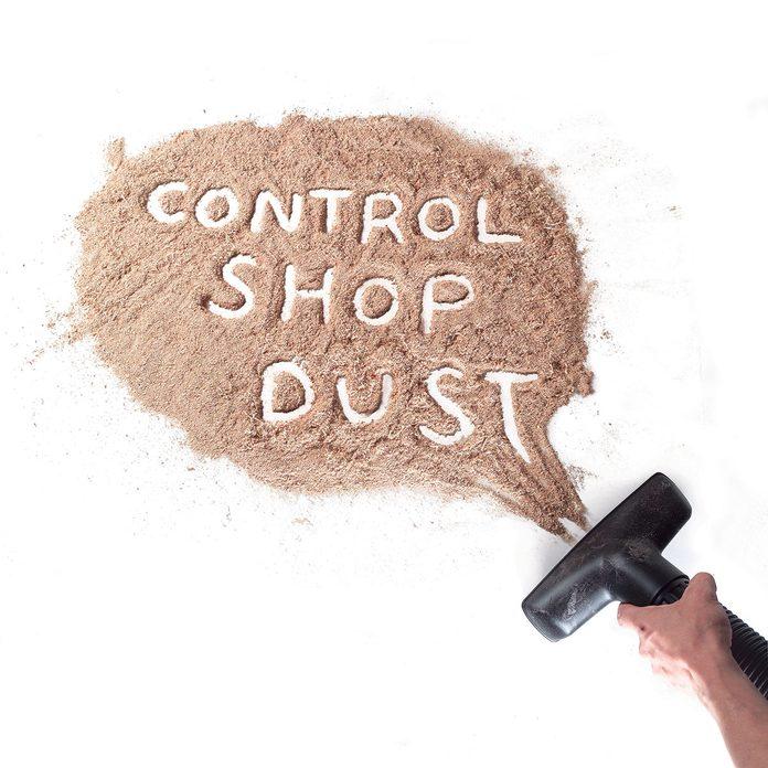 'Control Shop Dust' written in a pile of shop dust | Construction Pro Tips