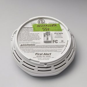 Why You Need a Piece of Tape on a Smoke Detector