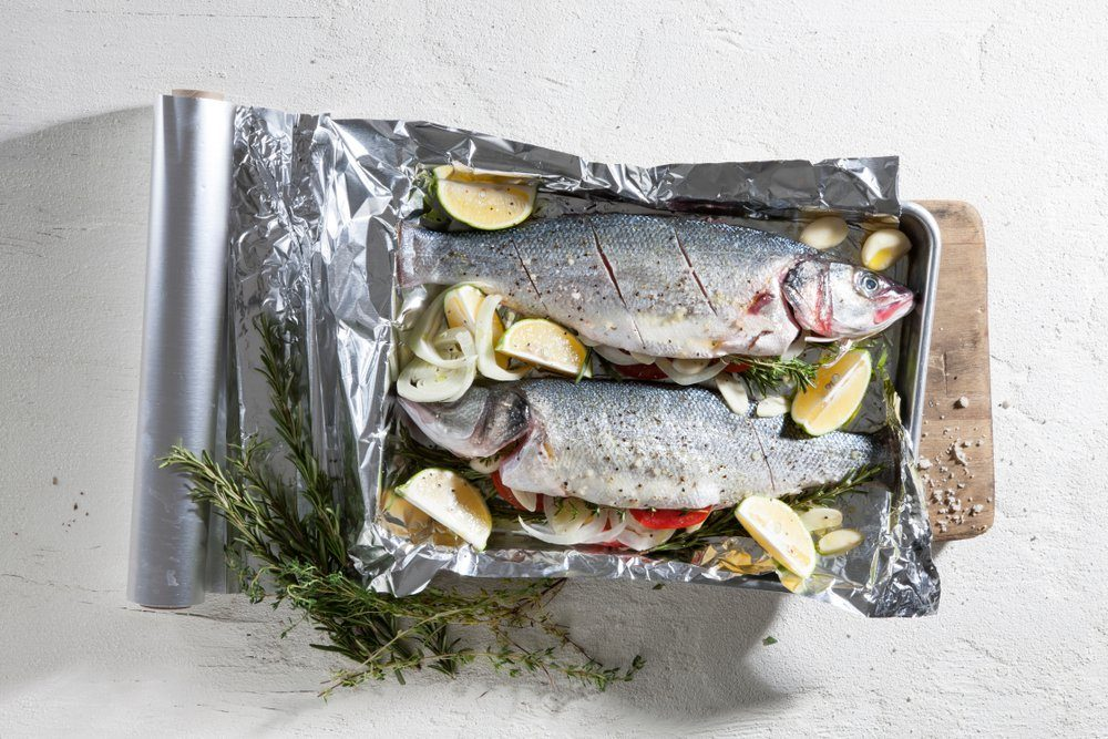 A whole fish in the oven- a traditional dish. Every ingredient in this course is natural and fresh. Top view food shot.