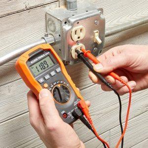 Multimeter testing outlet | Construction Pro Tips