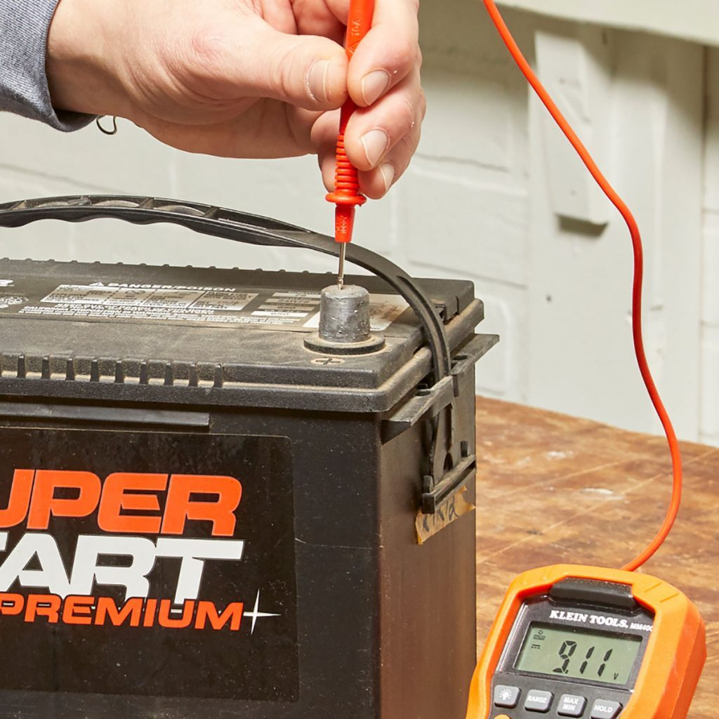 Positive test lead probe on battery | Construction Pro Tips