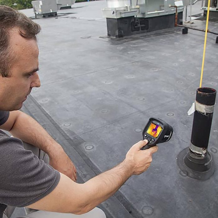 Man Taking a Picture With the FLIR E6 Compact Thermal Imaging Camera | Construction Pro Tips