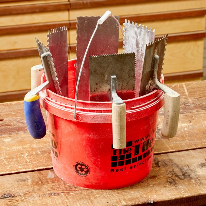 hanging trowels in a bucket
