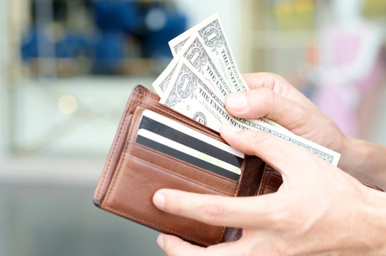 Hand of men use money from wallets. Pay the dollar Financial concepts and expenditures,