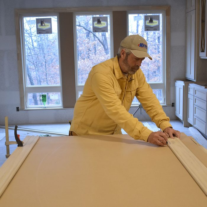 Marking parallel lines on template board   Construction Pro Tips