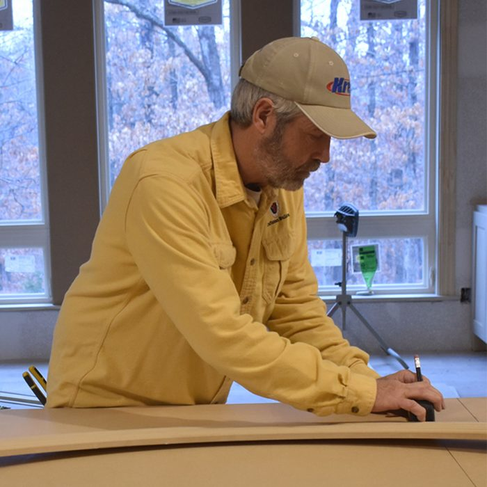 Marking where the radius trim will hit the casing   Construction Pro Tips