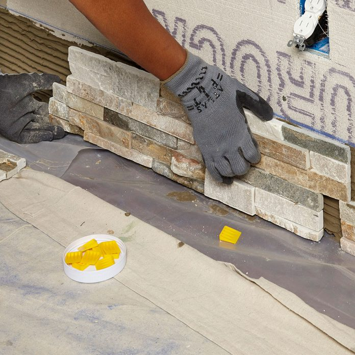 Place stone pieces along the bottom line   Construction Pro Tips