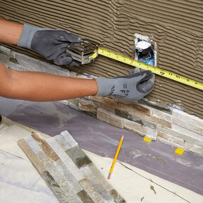 Measuring for an outlet opening   Construction Pro Tips
