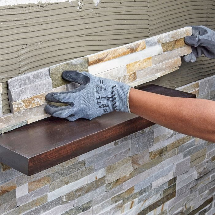 Laying stone over the shelf | Construction Pro Tips