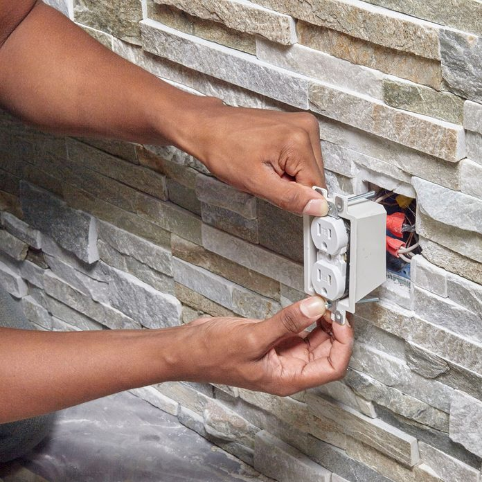 Placing the outlet in an opening   Construction Pro Tips