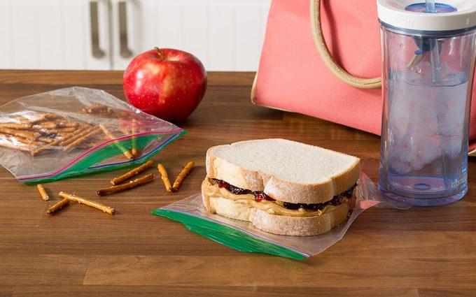 pretzels and pb&j sandwich sitting on zip-top bags