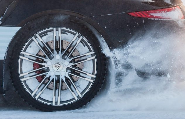LEVI, FINLAND - FEB 20: Rear wheel spin of a PORSCHE 911 TURBO car during Porsche Driving Experience Snow & Ice Press Event on February 20, 2014 in LEVI, FINLAND