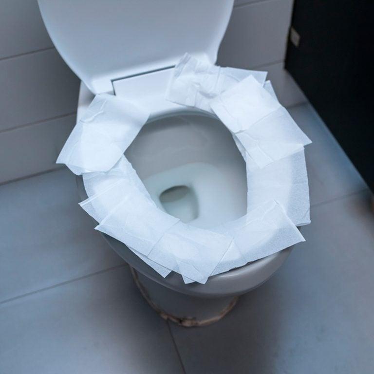 toilet paper on toilet seat