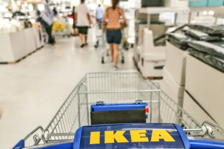 TEBRAU, JOHOR, MALAYSIA - 5 December 2017 : Close-up IKEA trolley in IKEA store with selective focus. People shopping at the largest IKEA store in South East Asia.