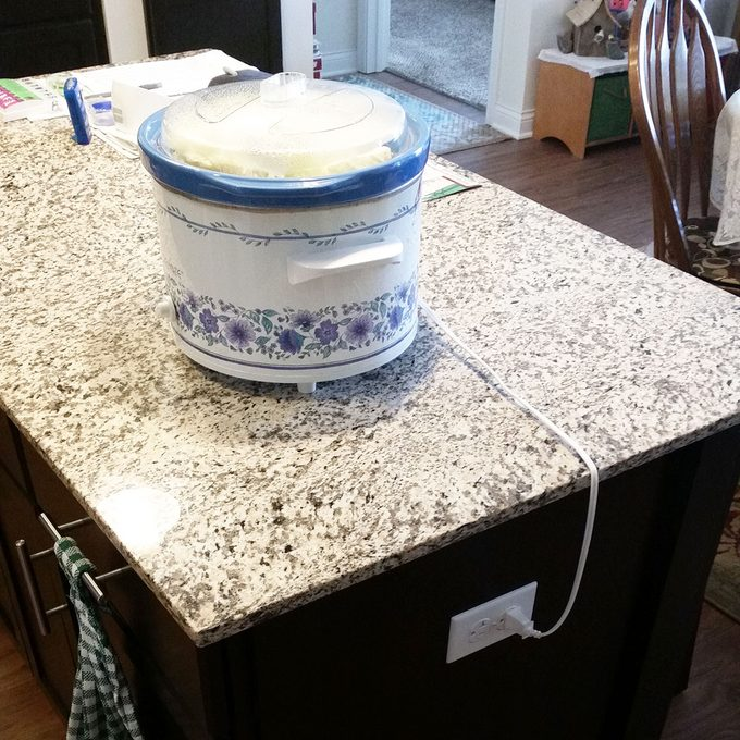 Crock pot plugged into an island electrical outlet   Construction Pro Tips