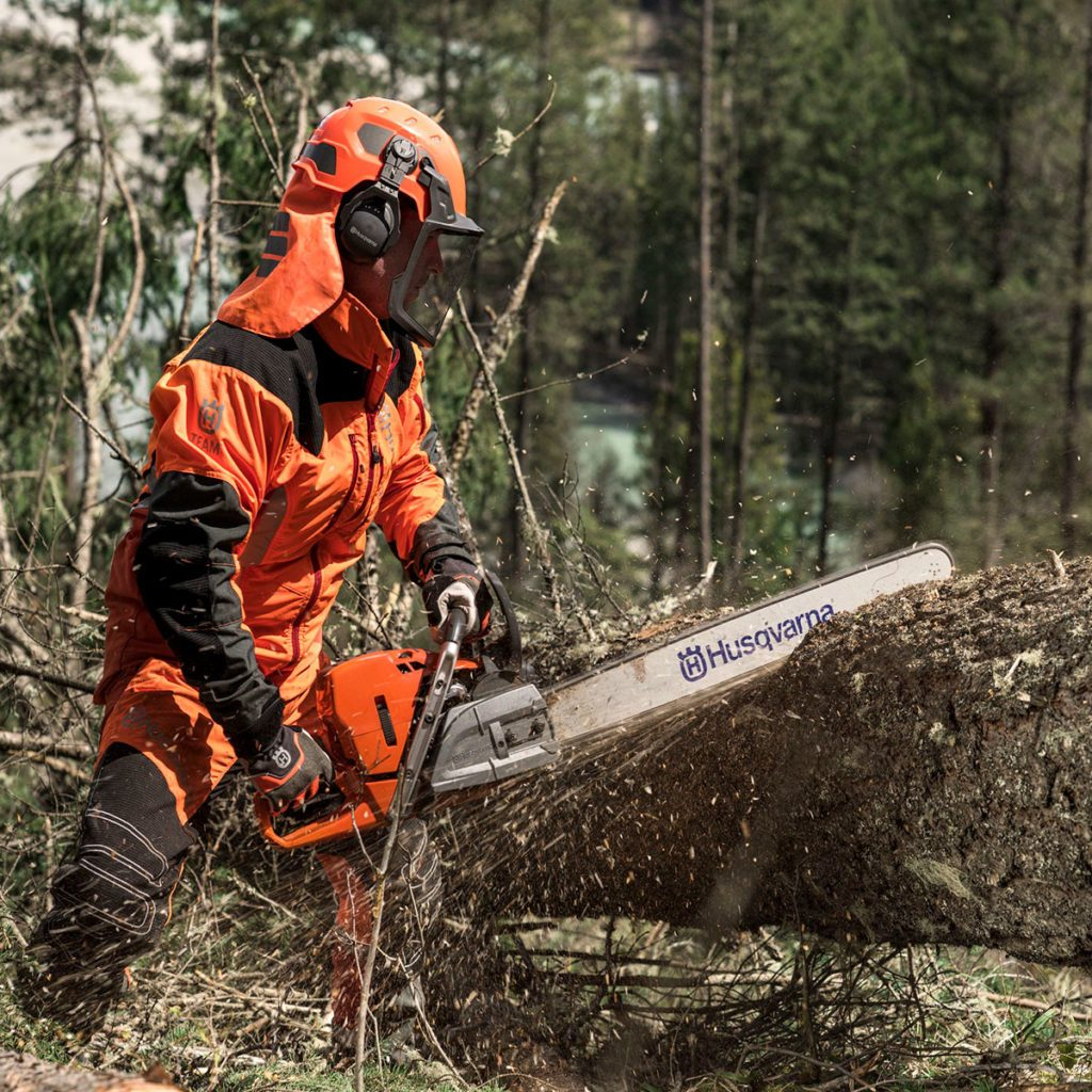Cutting into a fallen tree with a Husqvarna chainsaw | Construction Pro Tips