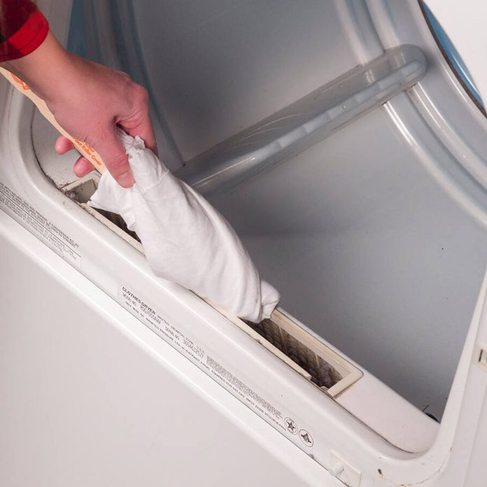 laundry room ideas cleaning around lint trap on dryer