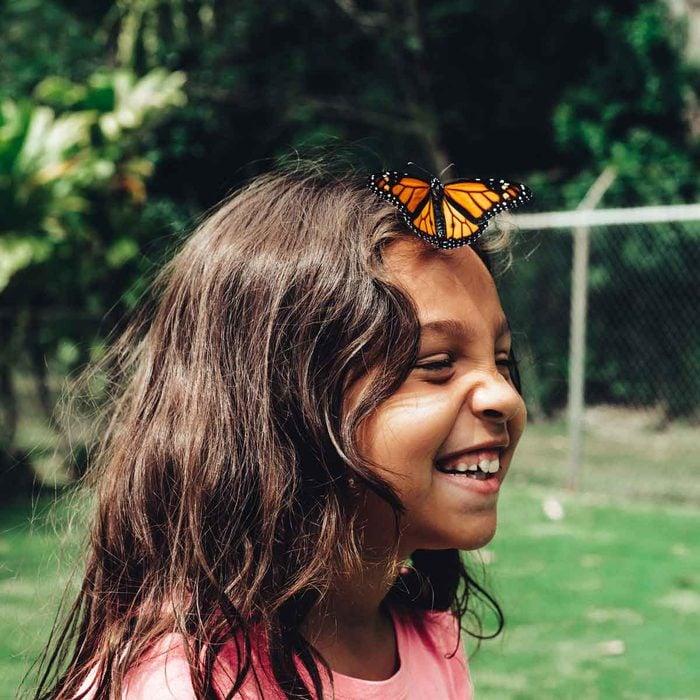 Butterfly On Girl's Head