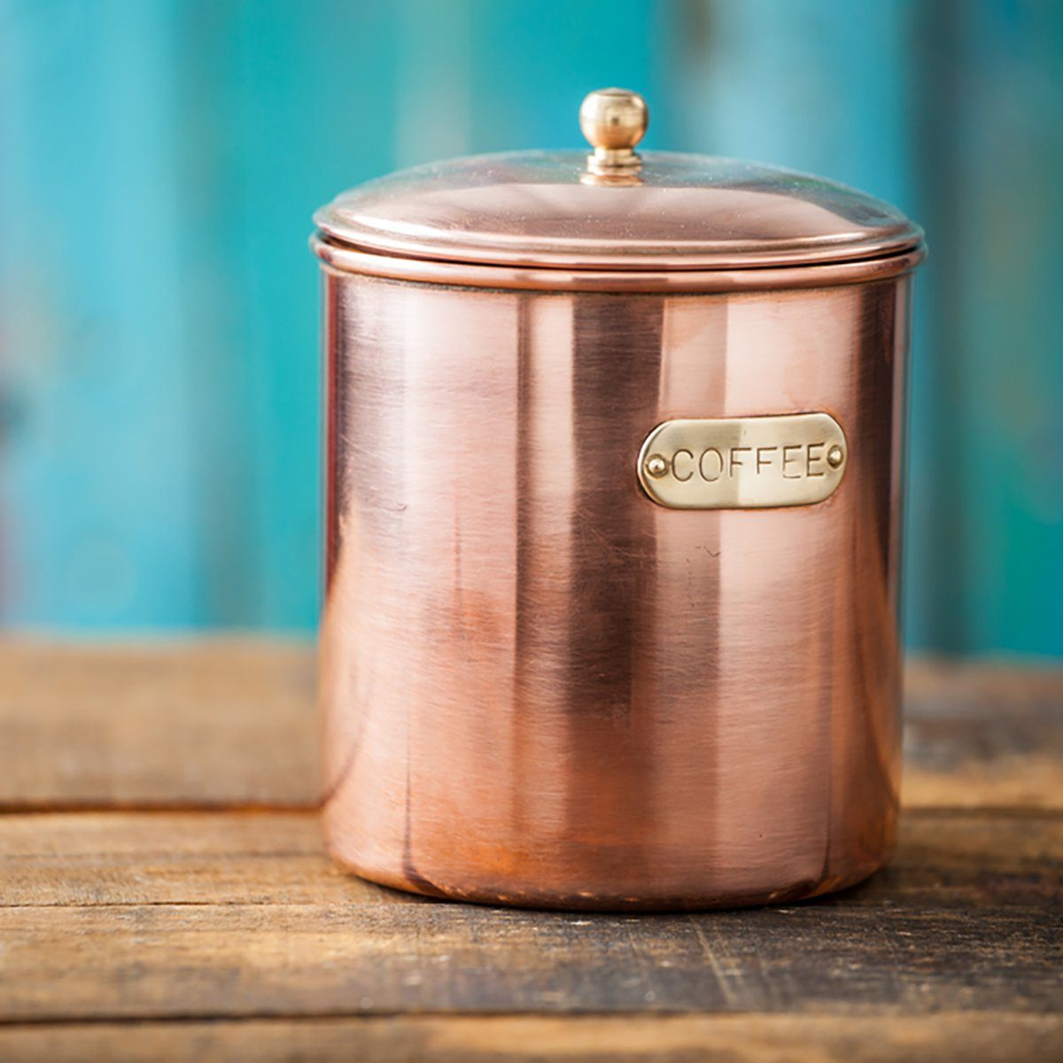 Antique Vintage Copper Coffee Container On Rustic Wood Background With Copy Space