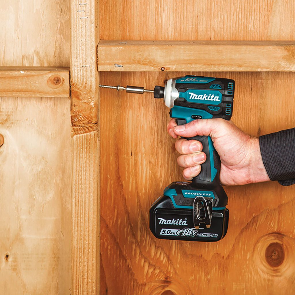 Hand holding a Makita compact driver   Construction Pro Tips