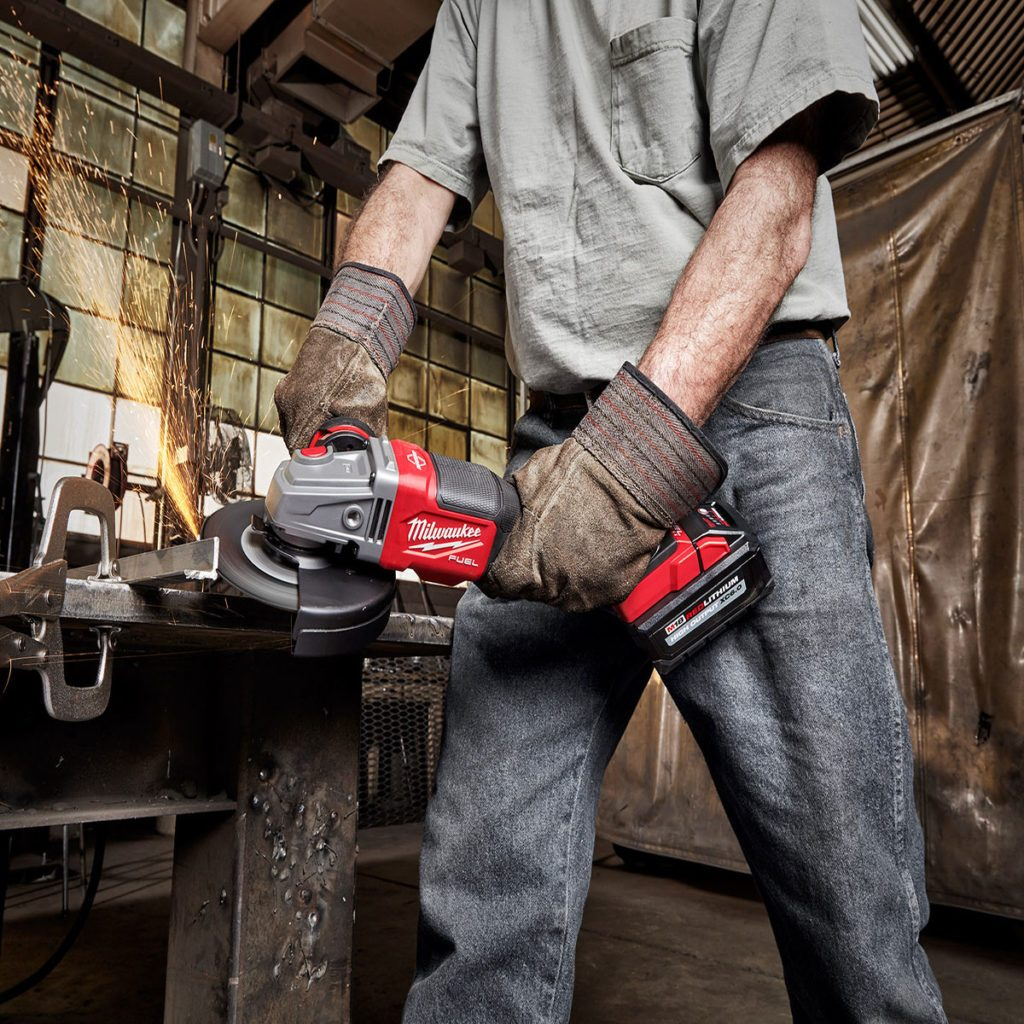 Man grinding metal with a cordless milwaukee grinder   Construction Pro Tips