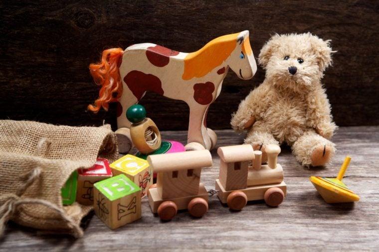 Vintage toys on wooden background