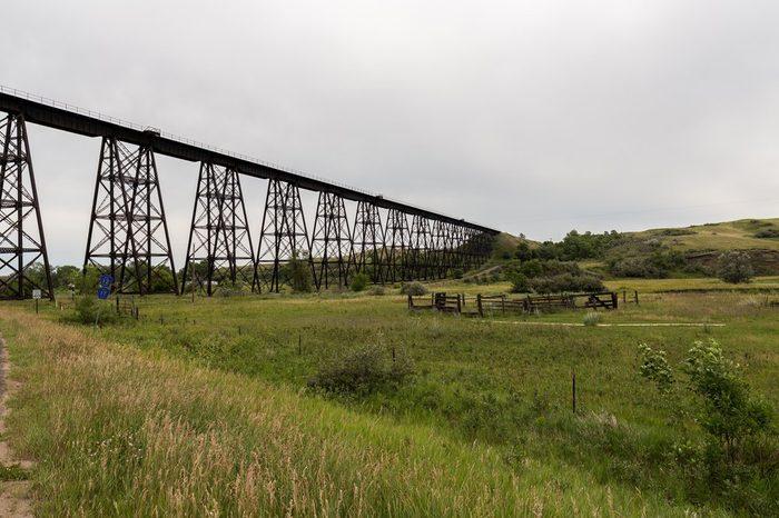 Steel truss railroad bridge west of Minot, North Dakota on a summer day.