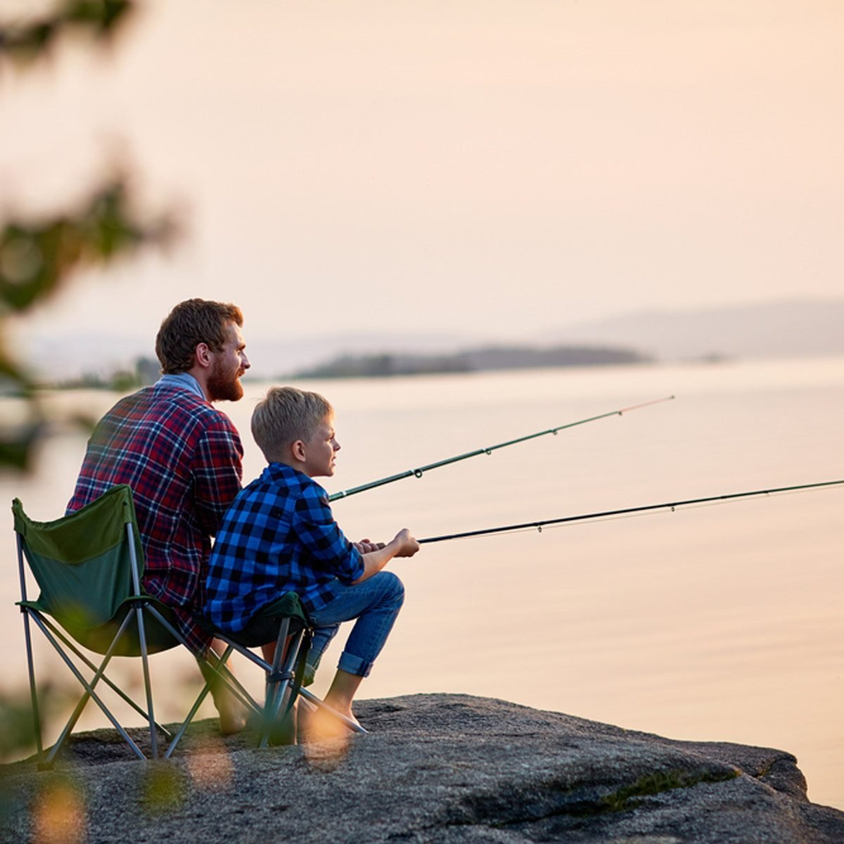 father and son fishing camping