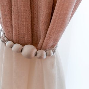 Our 12 Favorite DIY Curtain Tiebacks