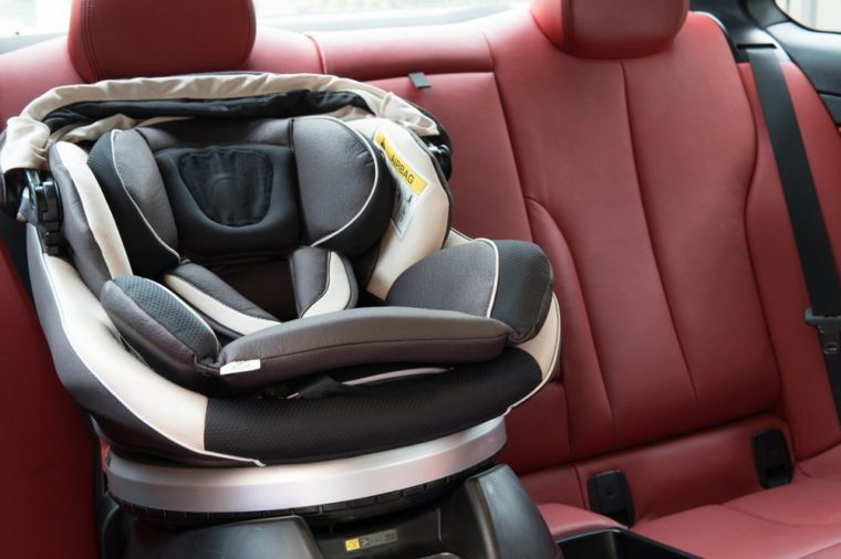 car seat placing in luxury sport car. baby safety concept.