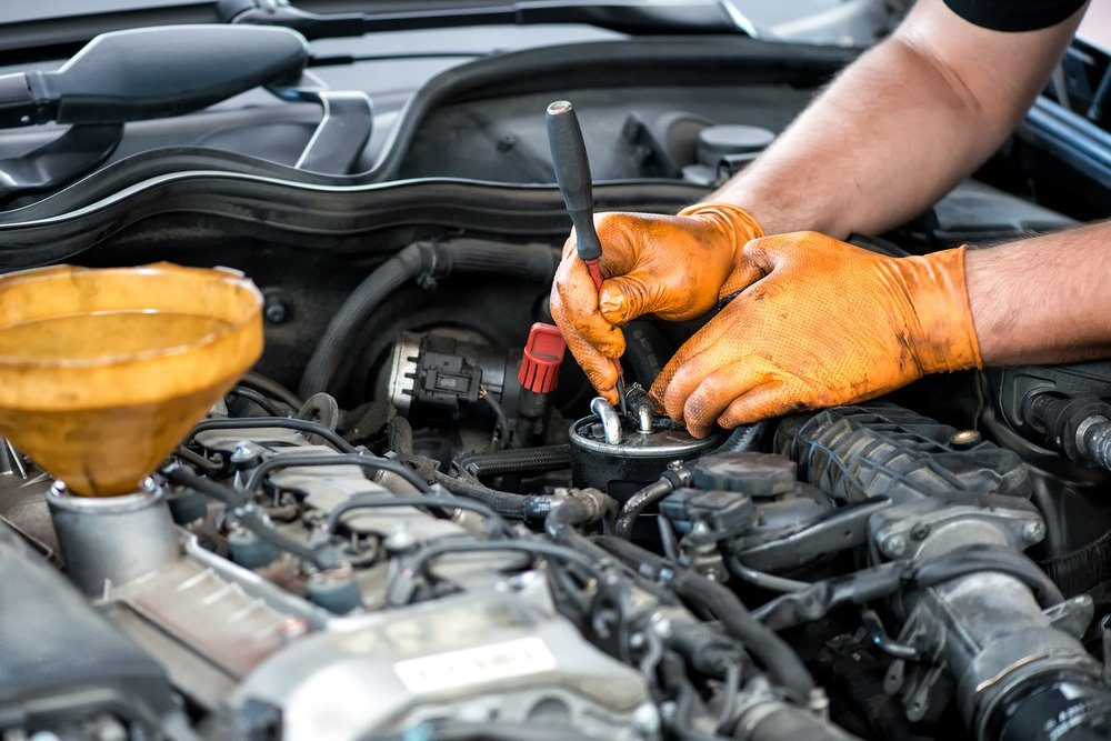 Mechanic working on a diesel filter, close up