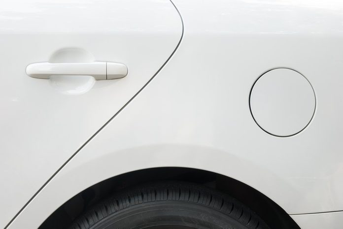 door and tyre and petrol cap cover of a white car