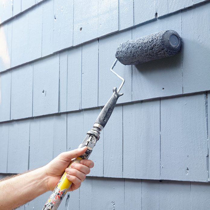 Rolling paint on to siding   Construction Pro Tips
